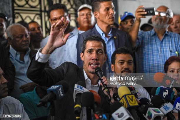 Venezuelan opposition leader and self-proclaimed acting president Juan Guaido gestures as he speaks during a press conference after a meeting with...