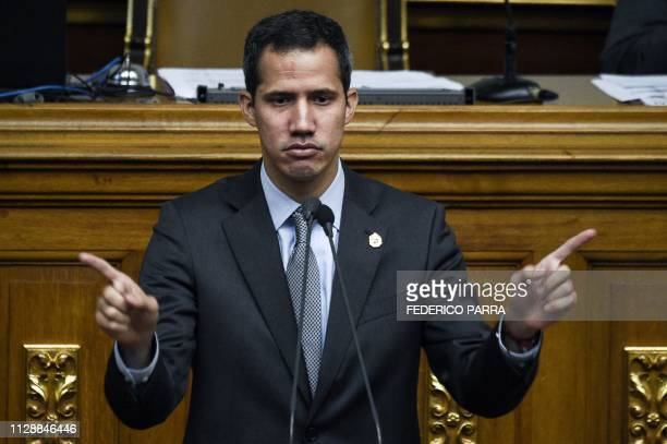 Venezuelan opposition leader and self-proclaimed acting president Juan Guaido gestures as he speaks during a session of the Venezuelan National...