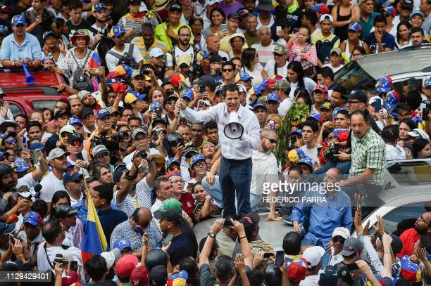 Venezuelan opposition leader and self-proclaimed acting president Juan Guaido speaks during a demo in Caracas on March 9, 2019. - Riot police blocked...