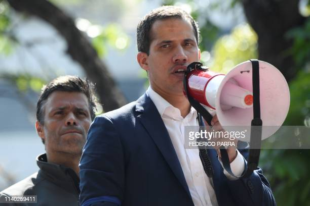 Venezuelan opposition leader and selfproclaimed acting president Juan Guaido speaks to supporters next to highprofile opposition politician Leopoldo...