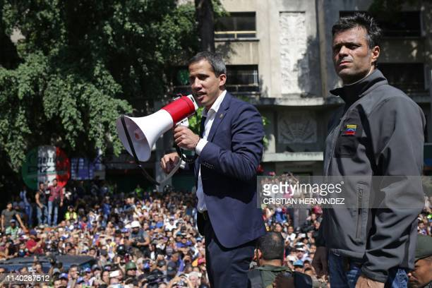 Venezuelan opposition leader and self-proclaimed acting president Juan Guaido speaks to supporters next to high-profile opposition politician...