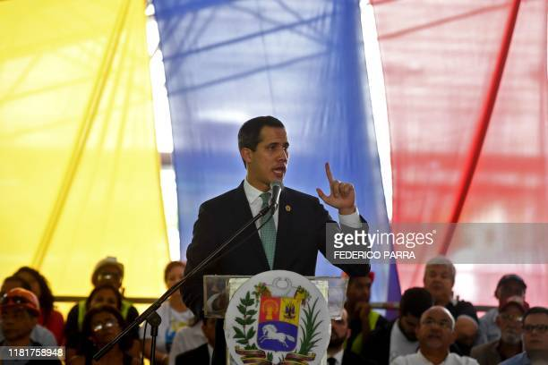 Venezuelan opposition leader and self-proclaimed acting president Juan Guaido speaks during a meeting with union leaders, in Caracas on November 11,...