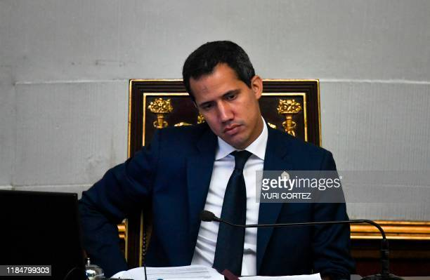 Venezuelan opposition leader and self-proclaimed acting president Juan Guaido, attends a Venezuelan National Assembly plenary session with the...