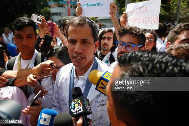Venezuelan opposition leader and selfproclaimed interim president Juan Guaido talks to the media during a demonstration against the government of...