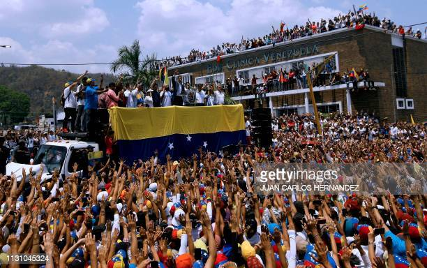 TOPSHOT Venezuelan opposition leader and selfproclaimed interim president Juan Guaido gestures as he delivers a speech during a rally in Valencia...