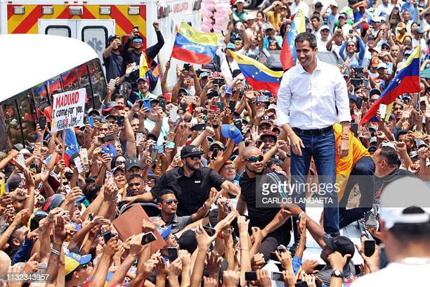 Venezuelan opposition leader and selfproclaimed interim president Juan Guaido greets supporters during a demostration in Barcelona Anzoategui State...