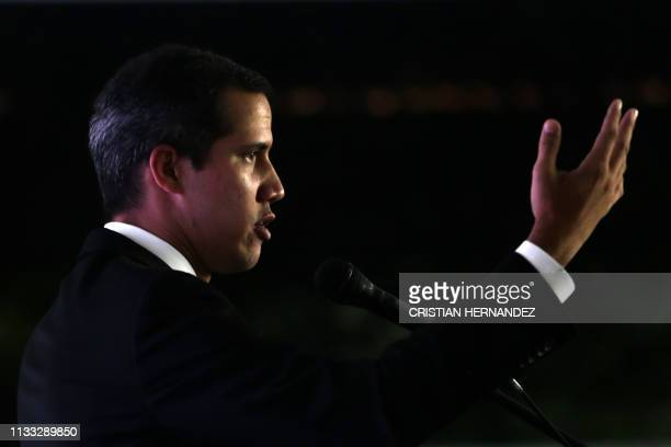 Venezuelan opposition leader and self-proclaimed interim president Juan Guaido delivers a speech during the presentation of his national...