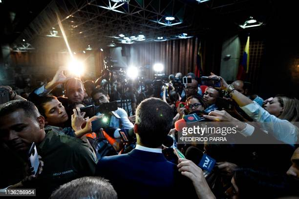 TOPSHOT Venezuelan opposition leader and selfproclaimed interim president Juan Guaido is surrounded by the press after speaking on security at the...
