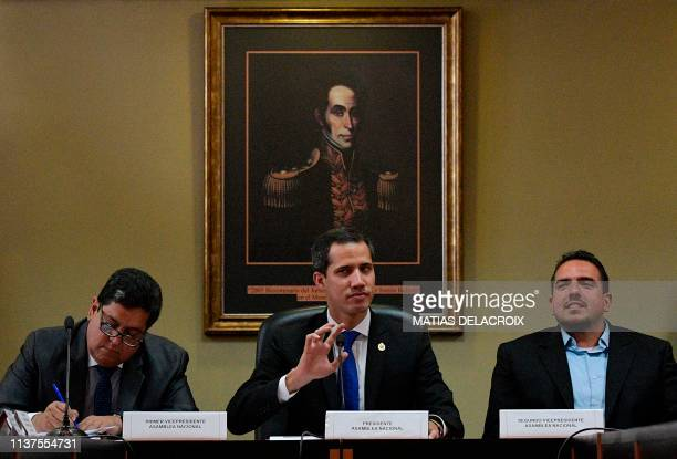 Venezuelan opposition leader and selfproclaimed interim president Juan Guaido flanked by the National Assembly's first vicepresident Edgar Zambrano...