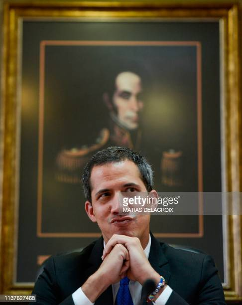 Venezuelan opposition leader and selfproclaimed interim president Juan Guaido gestures as he presides a consultation commission meeting at the...