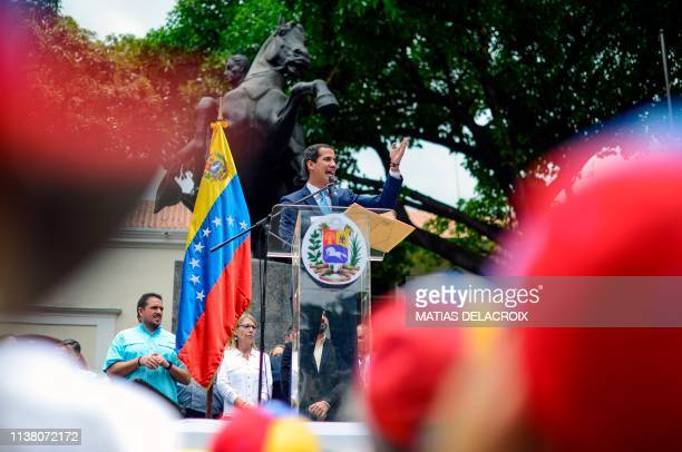 Venezuelan opposition leader and selfproclaimed interim president Juan Guaido addresses supporters during a meeting at Chacao neighbourhood in...