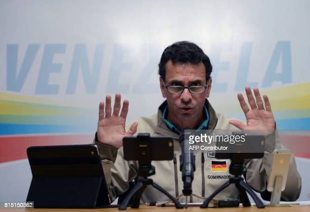 Venezuelan opposition leader Henrique Capriles Radonski speaks during his weekly internet broadcast, in Caracas on July 15, 2017. Political tensions...