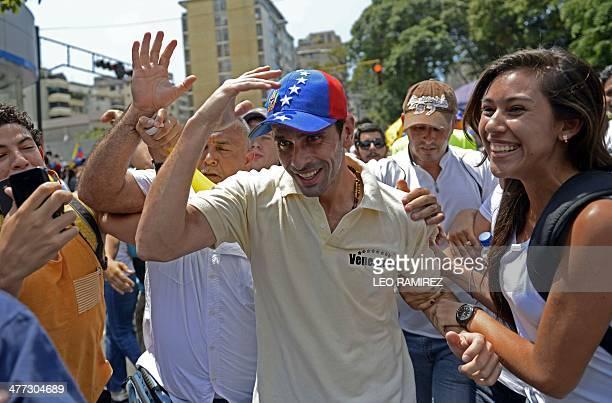 Venezuelan opposition leader Henrique Capriles Radonski takes part in a protest against Venezuelan President Nicolas Maduro in Caracas on March 8...
