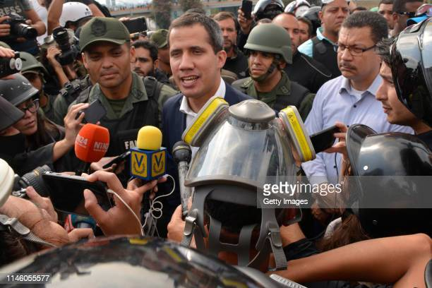 Venezuelan opposition leader Juan Guaidó, recognized by many members of the international community as the country's rightful interim ruler, talks to...