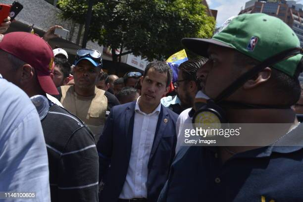 Venezuelan opposition leader Juan Guaidó recognized by many members of the international community as the country's rightful interim ruler walks...