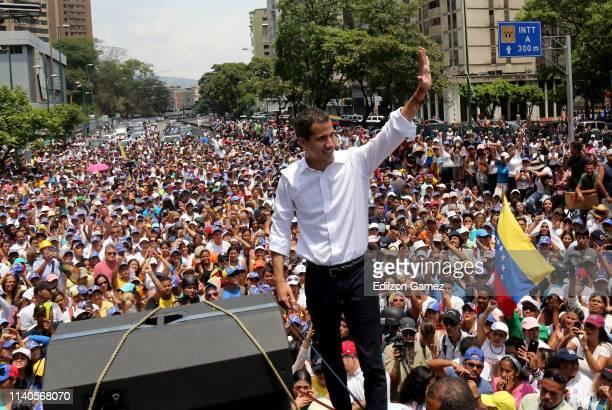Venezuelan opposition leader Juan Guaidó waves his supporters during a demonstration at avenida Francisco de Miranda on May 1 2019 in Caracas...