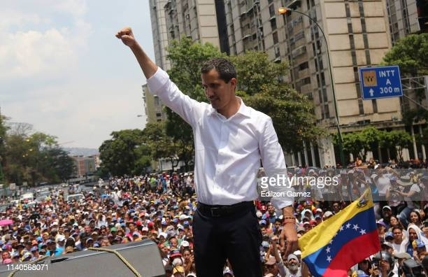 Venezuelan opposition leader Juan Guaidó waves his supporters during a demonstration at avenida Francisco de Miranda on May 1, 2019 in Caracas,...