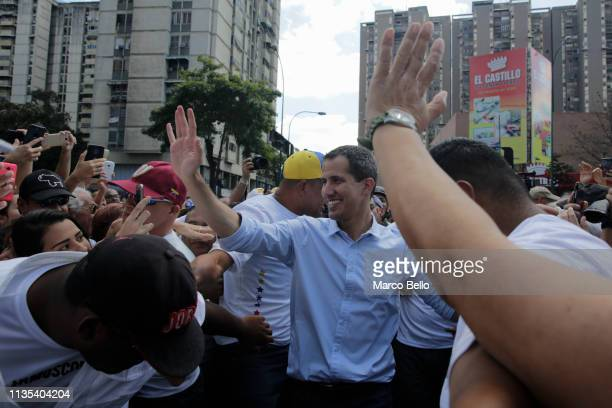 Venezuelan opposition leader Juan Guaido attends a rally with supporters on April 6 2019 in Caracas Venezuela Venezuelan opposition leader Juan...