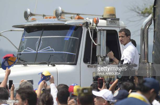 TOPSHOT Venezuelan opposition leader Juan Guaido gestures from the side of a truck at the Colombian side of the Tienditas International Bridge in...