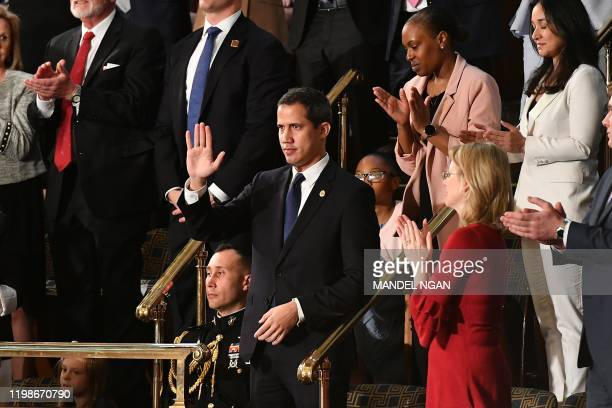 Venezuelan opposition leader Juan Guaido waves as he is acknowledged by US President Donald Trump during his the State of the Union address at the US...