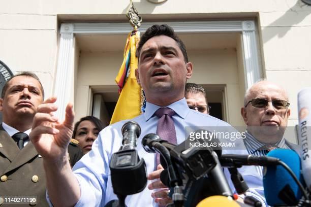 Venezuelan opposition leader Juan Guaido's ambassador to Washington, Carlos Vecchio, speak to the press outside the military attache's office in...