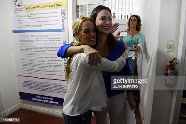 Venezuelan opposition leader Maria Corina Machado embraces Lilian Tintori wife of arrested opposition leader Leopoldo Lopez after a press conference...