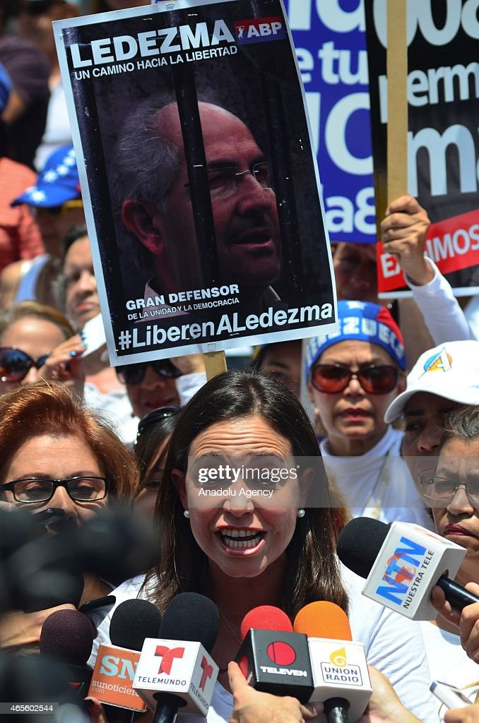 Venezuelan opposition leader Maria Corina Machado gives a speech during International Women's Day march in Caracas on March 8, 2015.