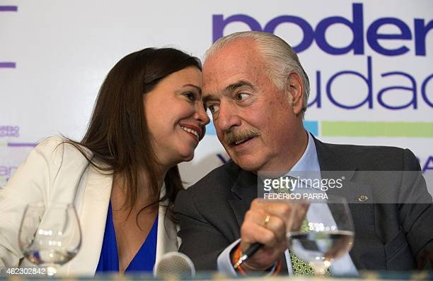 Venezuelan opposition leader Maria Corina Machado talks to former Colombian president Andres Pastrana during a press conference within the Citizen...
