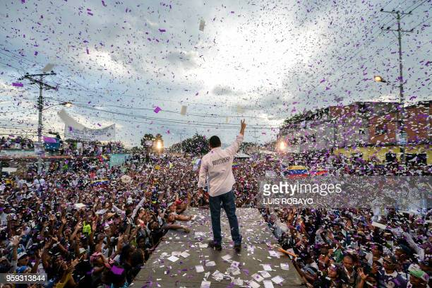 TOPSHOT Venezuelan opposition presidential candidate and evangelical pastor Javier Bertucci waves to supporters during his campaign closing rally in...