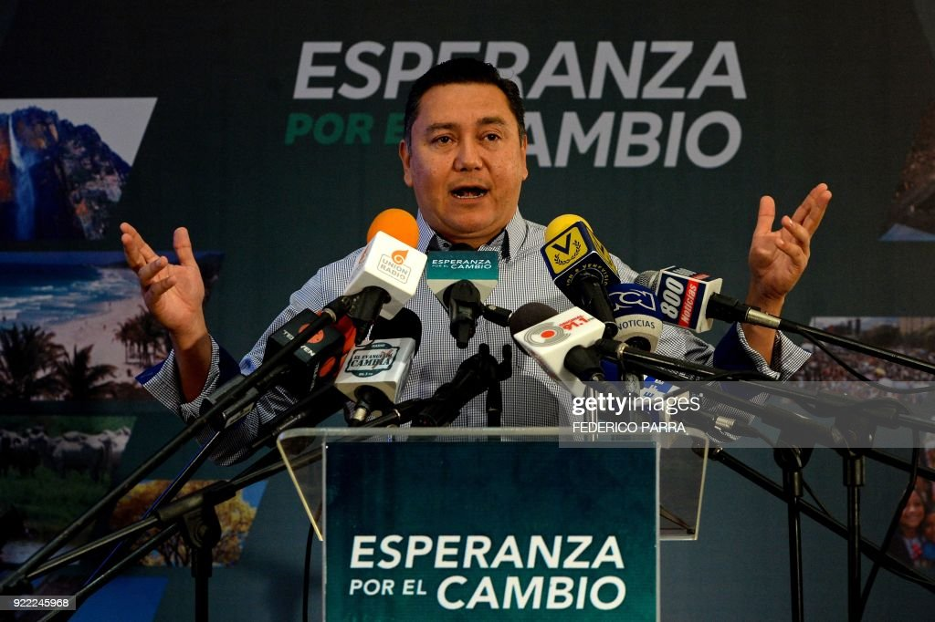 Venezuelan opposition presidential pre-candidate and evangelical pastor Javier Bertucci gestures during a press conference in Caracas on February 21, 2018. Maduro is running for another term in April 22 elections that most of opposition has vowed to boycott. /