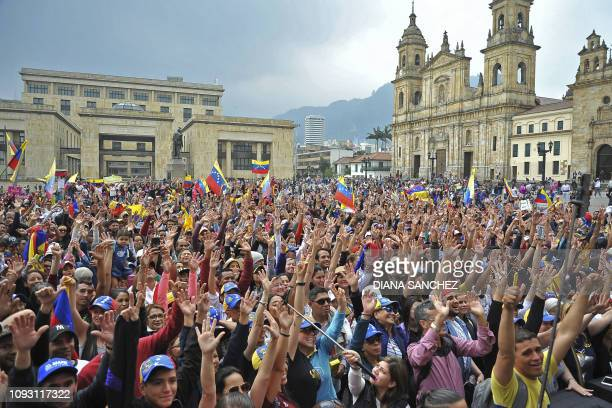 TOPSHOT Venezuelan opposition supporters living in Colombia take part in a demonstration to back Venezuelan opposition leader Juan Guaido's calls for...
