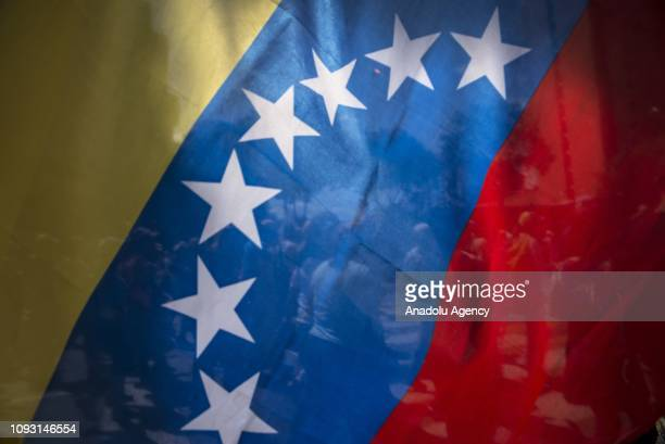 Venezuelan oppositions are seen through a Venezuelan flag march during a protest against Maduros government in Chacao District Caracas Venezuela on...