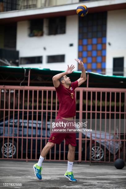 Venezuelan player of the national volleyball squad Jose Chema Carrasco practices service launch as training in isolation during the radical...