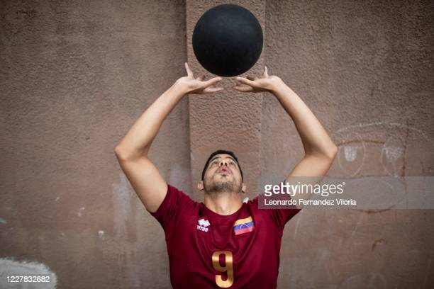 Venezuelan player of the national volleyball squad Jose Chema Carrasco flies the medicine ball as training in isolation during the radical quarantine...