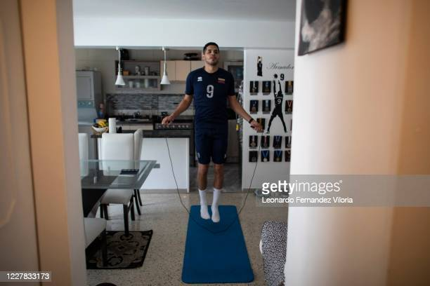 Venezuelan player of the national volleyball squad Jose Chema Carrasco jumps the rope a training in isolation in his 70 square meter apartment during...