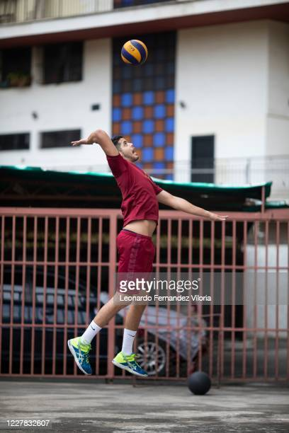 Venezuelan player of the national volleyball squad Jose Chema Carrasco makes a jump serve as training in isolation during the radical quarantine to...