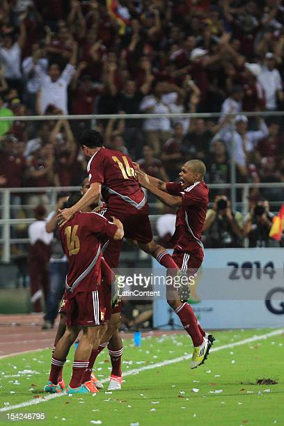 Venezuelan players celebrate a goal during a match between Venezuela and Ecuador during 2014 world cup qualifying soccer game at Jose Antonio...