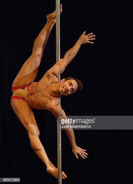 Venezuelan pole dancer Gregoris Garcia competes en route to winning in the Male South America 2013 Pole Dance competition in Buenos Aires on November...