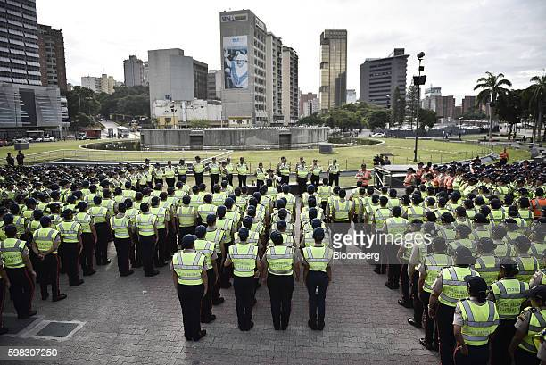 Venezuelan police stand ahead of an opposition march in Caracas Venezuela on Thursday Sept 1 2016 Venezuela's opposition is marching in Caracas to...