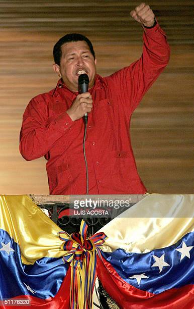 Venezuelan President Hugo Chavez addresses supporters in the Palace of Miraflores in Caracas 16 august 2004 Chavez won a referendum on his mandate...