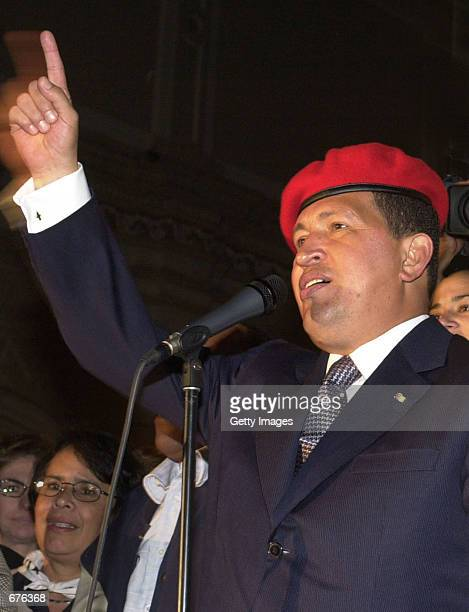 Venezuelan President Hugo Chavez addresses thousands Venezuelan citizens gathered around the presidential palace to celebrate Chavez's third year in...
