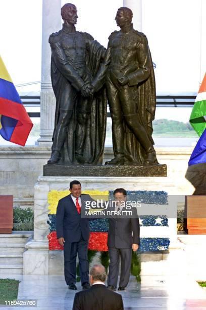 Venezuelan President Hugo Chavez and Argentinian President Eduardo Duhalde greet each other after placing a floral arrangement on the monument of...