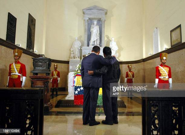 Venezuelan President Hugo Chavez and his Bolivian counterpart Evo Morales remain respectfully silent for a few moments after laying a wreath on the...
