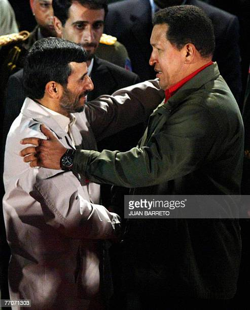 Venezuelan president Hugo Chavez and his Iranian counterpart Mahmoud Ahmadinejad greet each other 27 September at the Miraflores presidential palace...