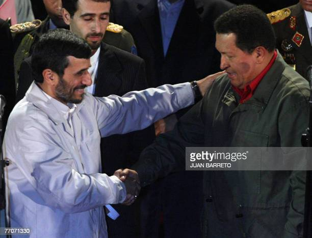 Venezuelan president Hugo Chavez and his Iranian counterpart Mahmoud Ahmadinejad shake hands 27 September at the Miraflores presidential palace in...