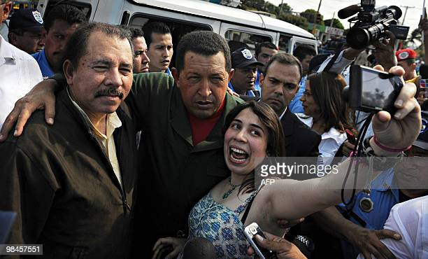 Venezuelan president Hugo Chavez and Nicaraguan President Daniel Ortega pose for a picture with an unidentified woman during a tour in Managua on...