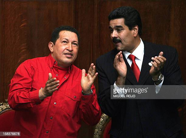 Venezuelan President Hugo Chavez and Venezuelan Minister of Foreign Affairs Nicolas Maduro applaud during the ceremony in which Uruguayan writer...