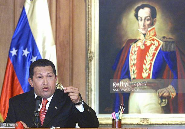 Venezuelan President Hugo Chavez answers a question during his first press conference after winning the recall referendum 16 August 2004 at the...