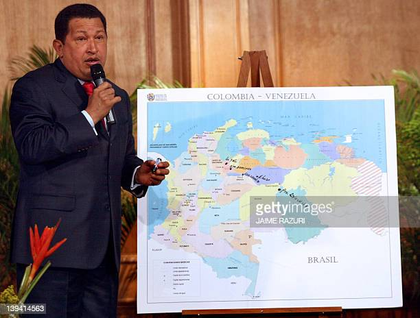 Venezuelan President Hugo Chavez explain on a map during a press conference 26 December 2007 at the presidential palace in Caracas the details and...