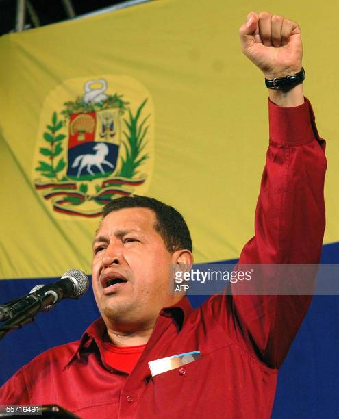 Venezuelan President Hugo Chavez gestures during a speech in front of Miraflores presidential palace in Caracas 18 September 2005 on his return from...